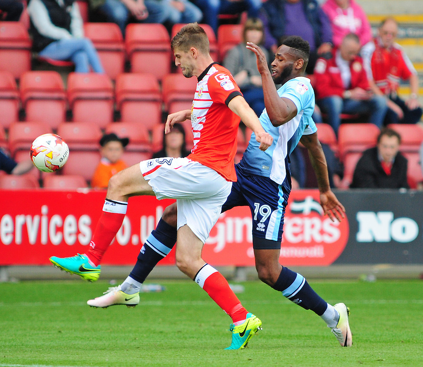 Blackpool's Jamille Matt vies for possession with Crewe Alexandra's Jon Guthrie<br /> <br /> Photographer Andrew Vaughan/CameraSport<br /> <br /> The EFL Sky Bet League Two - Crewe Alexandra v Blackpool - Saturday 24th September 2016 - Alexandra Stadium - Crewe<br /> <br /> World Copyright © 2016 CameraSport. All rights reserved. 43 Linden Ave. Countesthorpe. Leicester. England. LE8 5PG - Tel: +44 (0) 116 277 4147 - admin@camerasport.com - www.camerasport.com