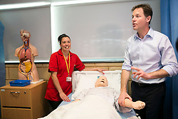 © Licensed to London News Pictures. 01/05/2015. Solihull, West Midlands, UK. Deputy Prime Minister Nick Clegg visiting Solihull College to meet Health and Social Care students. Pictured, Nick Clegg takes the pulse of Dummy Dave watched by student Emma Mutton. Photo credit : Dave Warren/LNP