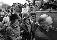 Marjorie Coulson, comforted by family members, follows the coffin of her fiance, Senator Billy Fox, 35 years, Protestant, Fine Gael politician, Co Monaghan, Rep of Ireland, 14th March 1974. He was previously a TD (Irish MP).  Fox was visiting the home near Clones of his fiancee, Marjorie Coulson, which unknown to him had been taken over by thirteen armed paramilitaries. He ran from the scene but was followed and shot dead in a nearby field. Five members of the Provisional IRA were subsequently tried and convicted of the killing. 197403140164n.<br />