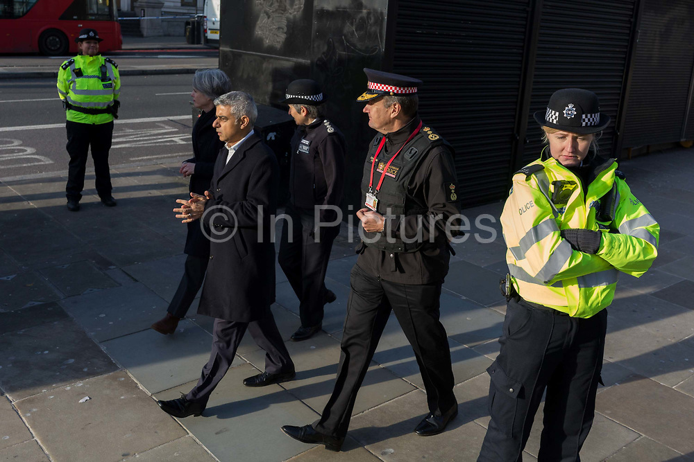 The morning after the terrorist attack at Fishmongers Hall on London Bridge, in which Usman Khan a convicted, freed terrorist killed 2 during a knife a attack, then subsequently tackled by passers-by and shot by armed police - Met Police Cressida Dick second left, London Mayor Sadiq Khan and City of London Commissioner Ian Dyson leave the crime scene, on 30th November 2019, in London, England.
