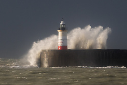 © Licensed to London News Pictures. 07/02/2016. Newhaven, East Sussex UK. Huge waves crash over the wall around Newhaven Lighthouse during gales and stormy weather this morning. Yellow weather warnings are in place for the south of England and many parts of the UK. Photo credit : Vickie Flores/LNP