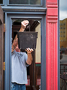 31 MAY 2020 - DES MOINES, IOWA: FRANK SINGLETON, from Elite Glass and Metal, pulls glass shards out of shattered window in front of Spaghetti Works, a popular restaurant in downtown Des Moines, after rioters shattered the windows. A group of rioters, protesting the death of George Floyd in police custody in Minneapolis, smashed windows in businesses and restaurants around the Polk County Courthouse in Des Moines. Des Moines police said they made 25 arrests Saturday night and very early Sunday morning. No one was hurt in the disturbances.      PHOTO BY JACK KURTZ
