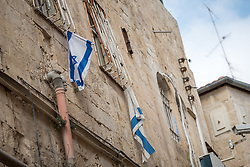 23 February 2020, Jerusalem: Israeli flags hang on a wall in the Jerusalem Old City.