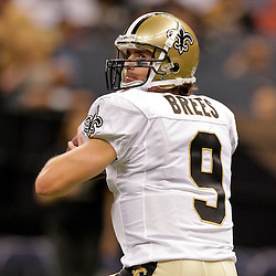 2009 October 04: New Orleans Saints quarterback Drew Brees (9) throws during warm ups prior to kickoff of a 24-10 win by the New Orleans Saints over the New York Jets at the Louisiana Superdome in New Orleans, Louisiana.