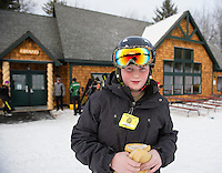 Travis French heads out for an evening of snowboarding at the Abenaki Ski Area in Wolfeboro.  (Karen Bobotas/for the Laconia Daily Sun)