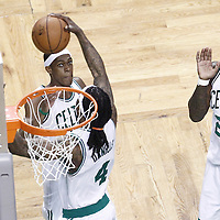 03 June 2012: Boston Celtics shooting guard Marquis Daniels (4) grabs a rebound while Boston Celtics point guard Rajon Rondo (9) and Boston Celtics small forward Mickael Pietrus (28) are watching during the Boston Celtics 93-91 overtime victory over the Miami Heat, in Game 4 of the Eastern Conference Finals playoff series, at the TD Banknorth Garden, Boston, Massachusetts, USA.