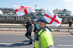 © Licensed to London News Pictures 29/05/2021. Dover, UK. Anti-immigration protest Dover. Demonstrators marching through Dover in Kent today in protest against immigration and the amount of migrants crossing the English Channel in small boats. Photo credit:Grant Falvey/LNP