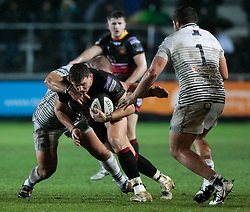 Dragons' Elliot Dee is tackled by Ospreys' Dimitri Arhip<br /> <br /> Photographer Simon King/Replay Images<br /> <br /> Guinness Pro14 Round 12 - Dragons v Cardiff Blues - Sunday 31st December 2017 - Rodney Parade - Newport<br /> <br /> World Copyright © 2017 Replay Images. All rights reserved. info@replayimages.co.uk - http://replayimages.co.uk