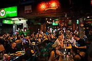 Tourists and visitors drinking at pubs in Khao San Road, Bangkok, Thailand.
