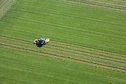 Nederland, Flevoland, Zuidelijk Flevoland,  08-09-2009. Het maaien van gras met een tractor doet geometrische patronen in het grasland ontstaan.Cutting grass with a tractor creates geometric patterns in the grassland .luchtfoto (toeslag); aerial photo (additional fee required); .foto Siebe Swart / photo Siebe Swart