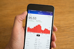 Detail of stock market performance of Apple company on a smart phone