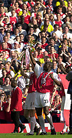 Foto: Peter Spurrier, Digitalsport<br /> NORWAY ONLY<br /> <br /> 15/05/2004  - 2003/04 Premiership Football - Arsenal v Leicester City<br /> <br /> Martin Keown [left] and Sol Campbell celebrate with the Trophy.