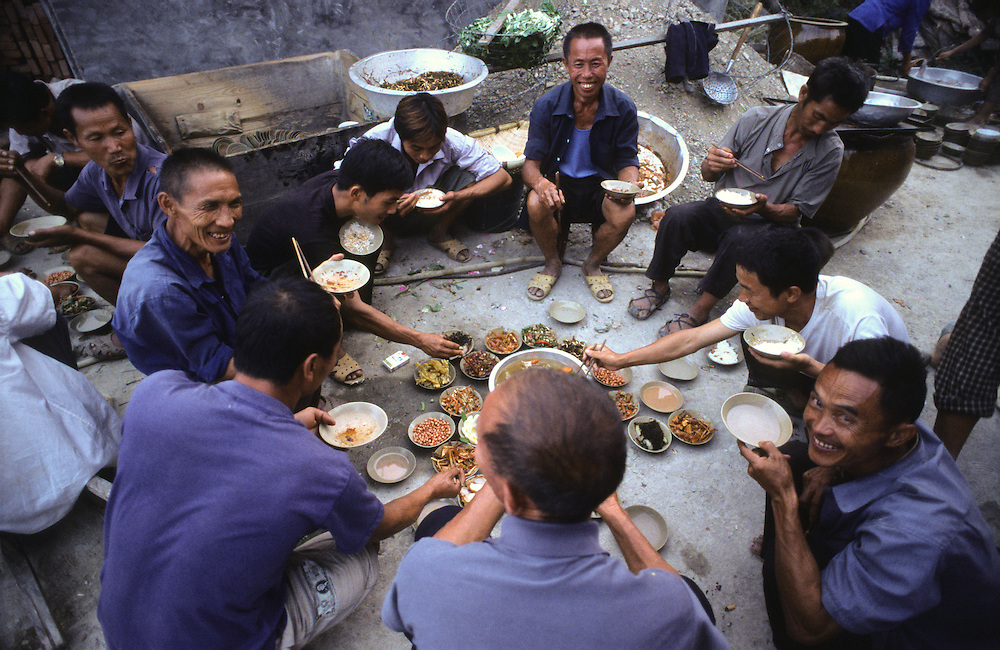 Villagers from the Miao ethnic group gather for eating and drinking in southern China's Guizhou province.