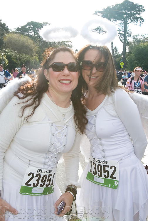 Laura Nasatir of Davis, Calif., left, and Becky Counter of Sacramento display their angelic selves during the 100th running of the Bay to Breakers 12K, Sunday, May 15, 2011 in San Francisco. (Photo by D. Ross Cameron)