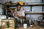 A man makes coffee and tea behind the bar of the Tahrir Cafe, Cairo, Egypt
