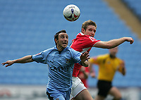 Photo: Lee Earle.<br /> Coventry City v Barnsley. Coca Cola Championship. 17/03/2007.Coventry's Michael Mifsud(L) and Paul Reid battle for the ball.