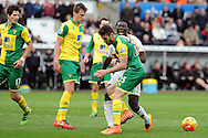 Swansea's Bafetimbi Gomis  looks anguished as Norwich's Ivo Pinto (25) tackles him. Barclays Premier league match, Swansea city v Norwich city at the Liberty Stadium in Swansea, South Wales on Saturday 5th March 2016.<br /> pic by  Carl Robertson, Andrew Orchard sports photography.