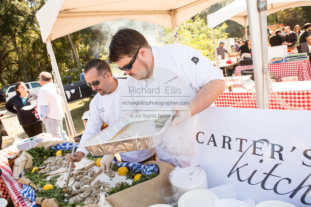Chefs from Carters's Kitchen prepare oysters during Cook it Raw outdoor BBQ event on Bowen's Island October 26, 2013 in Charleston, SC.