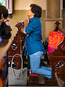 18 SEPTEMBER 2016 - BANGKOK, THAILAND: A woman prays in Santa Cruz Church before the church's 100th anniversary mass. Santa Cruz Church was establised in 1769 to serve Portuguese soldiers in the employ of King Taksin, who reestablished the Siamese (Thai) empire after the Burmese sacked the ancient Siamese capital of Ayutthaya. The church was one of the first Catholic churches in Bangkok and is one of the most historic Catholic churches in Thailand. The first sanctuary was a simple wood and thatch structure and burned down in the 1800s. The church is in its third sanctuary and was designed in a Renaissance / Neo-Classical style. It was consecrated in September, 1916. The church, located on the Chao Phraya River, serves as a landmark for central Bangkok.       PHOTO BY JACK KURTZ