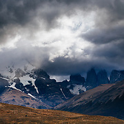 Clearing storm over gigantic granite monoliths shaped by the forces of glacial ice known as the three Towers of Paine in Torres del Paine National Park, Chile.