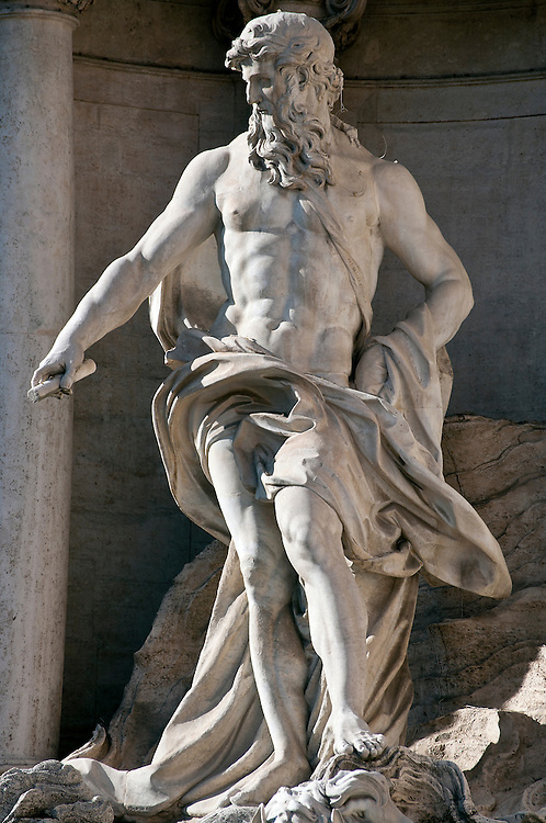 The statue at the top of the Trevi Fountain.