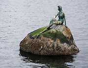 The Girl in Wetsuit statue by Elek Imredy was gifted to the Vancouver Park Board and unvield 1972, representing Vacouver's dependence on the sea. Coal Harbour, Vancouver, British Columbia, Canada.