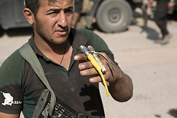Licensed to London News Pictures. 23/10/2016. An Iraqi Army engineer holds the detonators to a suicide belt he defused after being found in a local house in the recently liberated town of Bartella, Iraq.<br /> <br /> Bartella, a mainly Christian town with a population of around 30,000 people before being taken by the Islamic State in August 2014, was captured two days ago by the Iraqi Army's Counter Terrorism force as part of the ongoing offensive to retake Mosul. Although ISIS militants were pushed back a large amount of improvised explosive devices are still being found in the town's buildings. Photo credit: Matt Cetti-Roberts/LNP