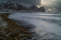 Large waves of winter storm casusing erosion in coastal dunes, Unstad beach, Vestvågøy, Lofoten Islands, Norway