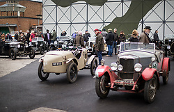 © Licensed to London News Pictures. 28/01/2018. Weybridge, UK. Vintage vehicles are lined up at Brooklands Museum as members of The Vintage Sports-Car Club take part in New Year driving tests. Photo credit: Peter Macdiarmid/LNP