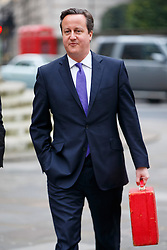 © Licensed to London News Pictures. 04/01/2015. LONDON, UK. Prime Minister David Cameron arrives BBC Broadcasting House in London to take part on the The Andrew Marr show on BBC One on Sunday, 4 January 2014. Photo credit : Tolga Akmen/LNP