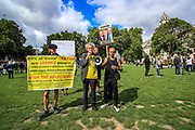 Piers Corbyn addresses a small group of anti-vaxxers who are seen to gather outside Westminster Palace, Houses of Parliament in central London on Wednesday, Aug 18, 2021. They said they're gathering to protest the continuation of the Covid19 vaccine across the country. (VX Photo/ Vudi Xhymshiti)