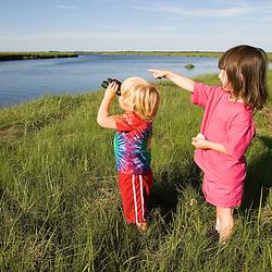 Kids studying nature in Plum Island Sound Rowley Massachusetts USA