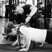 Olympic cyclist Monique Sullivan works with Canadian Sport Institute Calgary strength and conditioning coach Chris Osmond on October 24, 2014 in Calgary, Alberta.