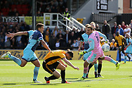 Padraig Amond of Newport county © fails to connect with a header at goal with Wycombe goalkeeper Scott Brown beaten. EFL Skybet football league two match, Newport county v Wycombe Wanderers at Rodney Parade in Newport, South Wales on Saturday 9th September 2017.<br /> pic by Andrew Orchard, Andrew Orchard sports photography.