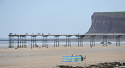 © Licensed to London News Pictures. 27/05/2013..Saltburn, England..Visitors to the beach enjoy the warm bank holiday weather at Saltburn by the Sea in Cleveland....Photo credit : Ian Forsyth/LNP
