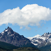 The distinctive, sharp triangle-shaped mountain is Monte Olivia (Mount Olivia).