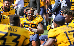 Sep 14, 2019; Morgantown, WV, USA; West Virginia Mountaineers defensive lineman Darius Stills (56) smiles along the sidelines during the fourth quarter against the North Carolina State Wolfpack at Mountaineer Field at Milan Puskar Stadium. Mandatory Credit: Ben Queen-USA TODAY Sports