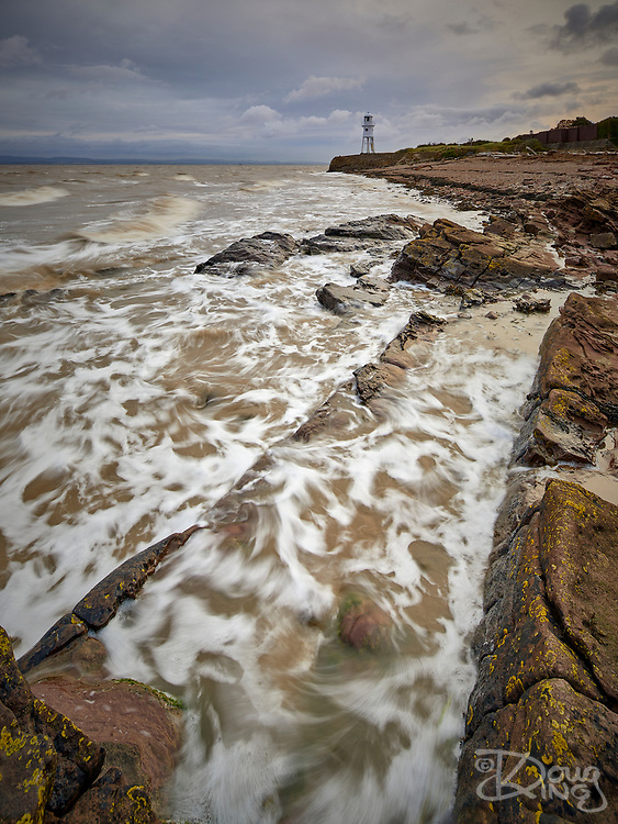 Black Nore Point, Portishead, at high tide with the old lighthouse in the background.