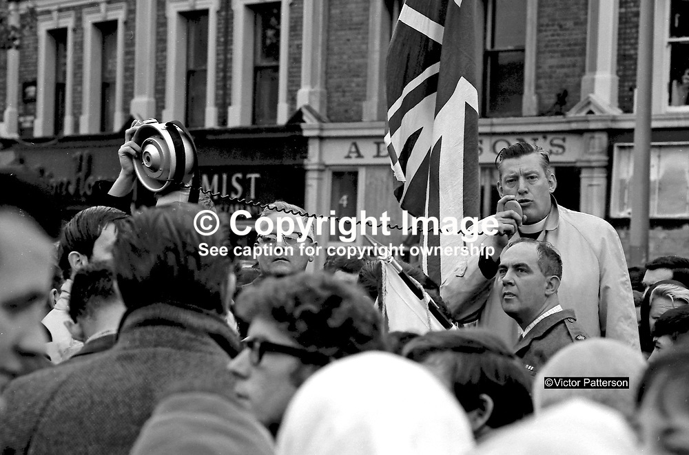 Rev Ian Paisley, moderator, Ulster Free Presbyterian Church, and Ronald Bunting, commandant of the Loyal Citizens of Ulster, at a meeting in Shaftesbury Square, Belfast, N Ireland, BGE A0503, 196800000297, LH 297/68.<br /> <br /> Copyright Image from Victor Patterson, Belfast, UK<br /> <br /> t: +44 28 9066 1296 (from Rep of Ireland 048 9066 1296)<br /> m: +44 7802 353836<br /> e: victorpattersonbelfast@gmail.com<br /> <br /> www.images4media.com<br /> <br /> Please see my full Terms and Conditions of Use at https://www.images4media.com/p/terms-conditions - it is IMPORTANT that you familiarise yourself with them.<br /> <br /> Images used online incur an additional cost. This cost should be agreed in writing in advance. Online images must be visibly watermarked i.e. © Victor Patterson or that of the named photographer within the body of the image. The original metadata must not be deleted from images used online.<br /> <br /> This image is only available for the use of the download recipient i.e. television station, newspaper, magazine, book publisher, etc, and must not be passed on to a third party. It is also downloaded on condition that each and every usage is notified within 7 days to victorpattersonbelfast@gmail.com.<br /> <br /> The right of Victor Patterson (or the named photographer) to be identified as the author is asserted in accordance with The Copyright Designs And Patents Act (1988). All moral rights are asserted.
