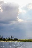 Storm clouds gather over a coastal salt marsh in Georgia.