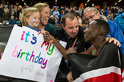 London, August 08 2017 . Conseslus Kipruto, Kenya, wishes a little girl happy birthday after becoming world champion in the men's 3,000m steeplechase final on day five of the IAAF London 2017 world Championships at the London Stadium. © Paul Davey.