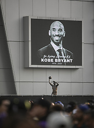 January 26, 2020, Los Angeles, California, USA: A photo next to a the statue of Kareem Abdul-Jabbar at a memorial held at Staples Center for former Los Angeles Lakers player Kobe Bryant who died in a Helicopter crash on Sunday, January 26, 2020 in Calabasas, California. He was 41. JAVIER ROJAS/PI (Credit Image: © Prensa Internacional via ZUMA Wire)