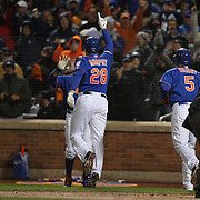 Daniel Murphy, New York Mets, celebrates at home plate after hitting a home run during the MLB NLCS Playoffs game two, Chicago Cubs vs New York Mets at Citi Field, Queens, New York. USA. 18th October 2015. Photo Tim Clayton