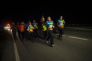 """People run on the 20th Korrika. castejon. (Basque Country). March 31, 2017. The """"Korrika"""" is a relay course, with a wooden baton that passes from hand to hand without interruption, organised every two years in a bid to promote the basque language. The Korrika runs over 11 days and 10 nights, crossing many Basque villages and cities. This year was the 20th edition and run more than 2500 Kilometres. Some people consider it an honour to carry the baton with the symbol of the Basques, """"buying"""" kilometres to support Basque language teaching. (Gari Garaialde / Bostok Photo)"""