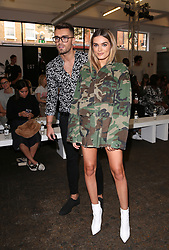 Josh Cuthbert and Chloe Lloyd attend the 'Streets of EQT', a street style presentation to celebrate Hailey Baldwin's new Adidas EQT campaign during London Fashion Week SS18 held at The Old Truman Brewery, London. Picture Date: Friday 15 September. Photo credit should read: Isabel Infantes/PA Wire