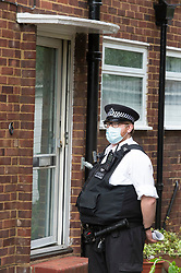 © Licensed to London News Pictures 06/06/2021. <br /> Bexleyheath, UK. A policeman outside the front door. A man has been arrested on suspicion of murder after the body of an 89 year old woman was found dead at a property in Bexleyheath, London yesterday, police are still on scene. Photo credit:Grant Falvey/LNP