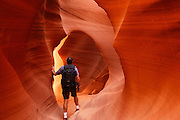 Visitor in Lower Antelope Slot Canyon on Navajo land, Page, Arizona.  (model relesed)