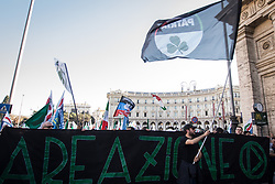 October 14, 2017 - Rome, Italy, Italy - Rome, Italy October 14,2017 Demonstrators hold a sign reading ''Enough immigration, Italians first!'' as they participate in a march in favour of labor and against irregular immigration staged by the National Movement for Sovereignty (Movimento Nazionale per la Sovranità) in Rome, Italy, 14 October 2017. ..in the pictured a moment demonstration (Credit Image: © Andrea Ronchini/Pacific Press via ZUMA Wire)