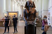 Now re-opened after months of closure during the Coronavirus pandemic, some of the first visitors who have pre-booked free tickets, once again enjoy ancient Egyptian artifacts at the British Museum, on 2nd September 2020, in London, England.