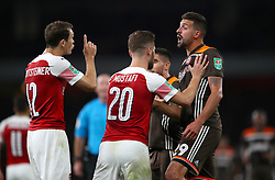 Arsenal's Stephan Lichtsteiner (left) and Brentford's Yoann Barbet ezchange words during the Carabao Cup, Third Round match at the Emirates Stadium, London.